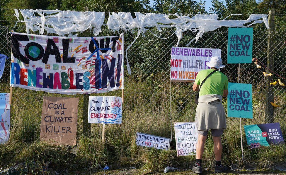 Protesters outside the planned site