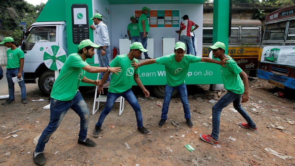 Actors in WhatsApp shirts perform a skit in Jaipur in October 2018