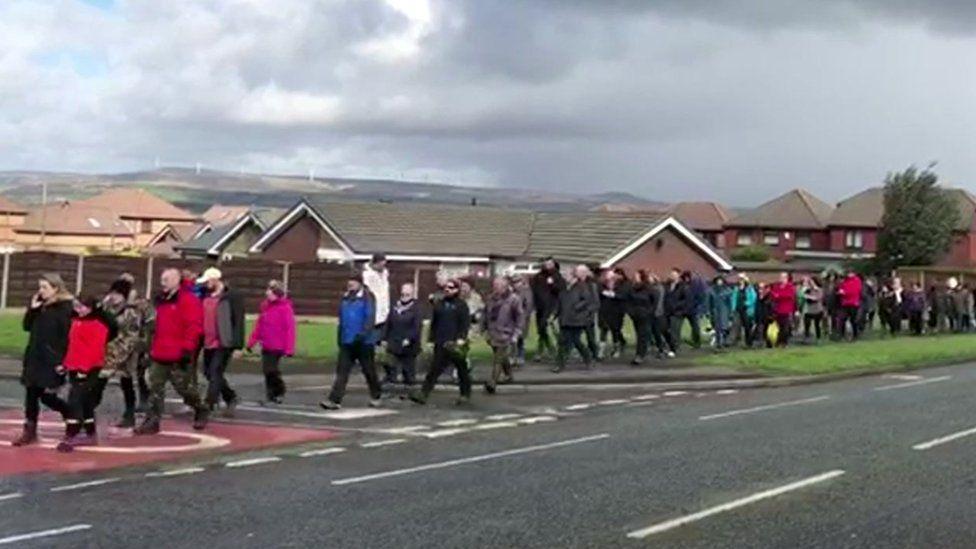 people marching through Bury