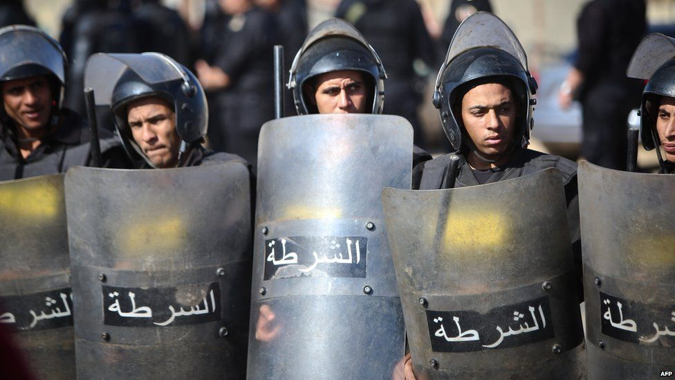 Egyptian police officers stand in front of the police academy in Cairo during the trial of Egypt's former President Hosni Mubarak on 29 November 2014