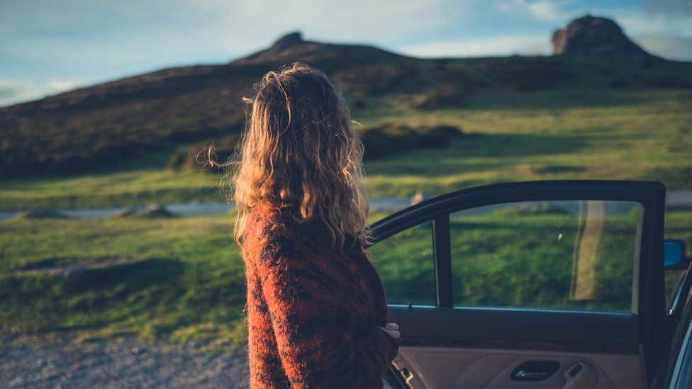 Woman looks at countryside