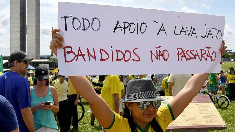 Demonstrators protest in front of the National Congress in Brasilia in support of the Lava Jato anti-corruption operation investigating the Petrobras bribes scandal. The placard reads 'All Support to Lava Jato-Crooks Shall Not Pass'