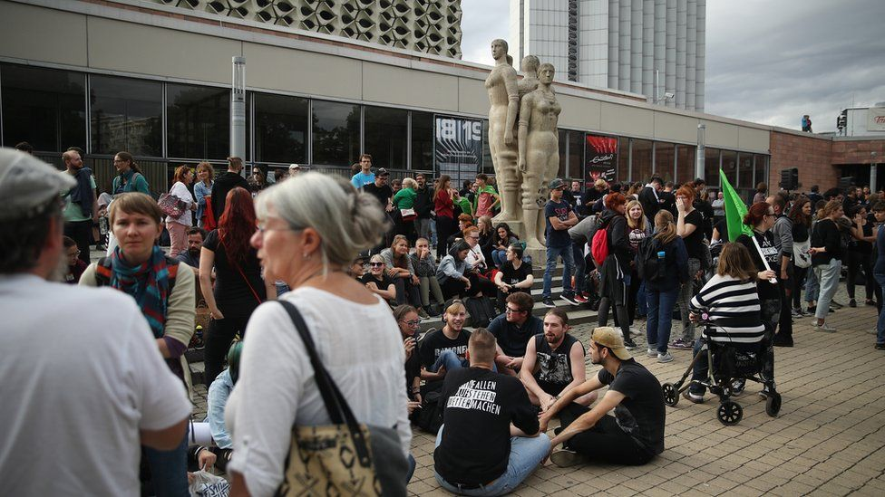 People gather for a demonstration to protest against racism and right-wing extremism in Chemnitz, 27 August