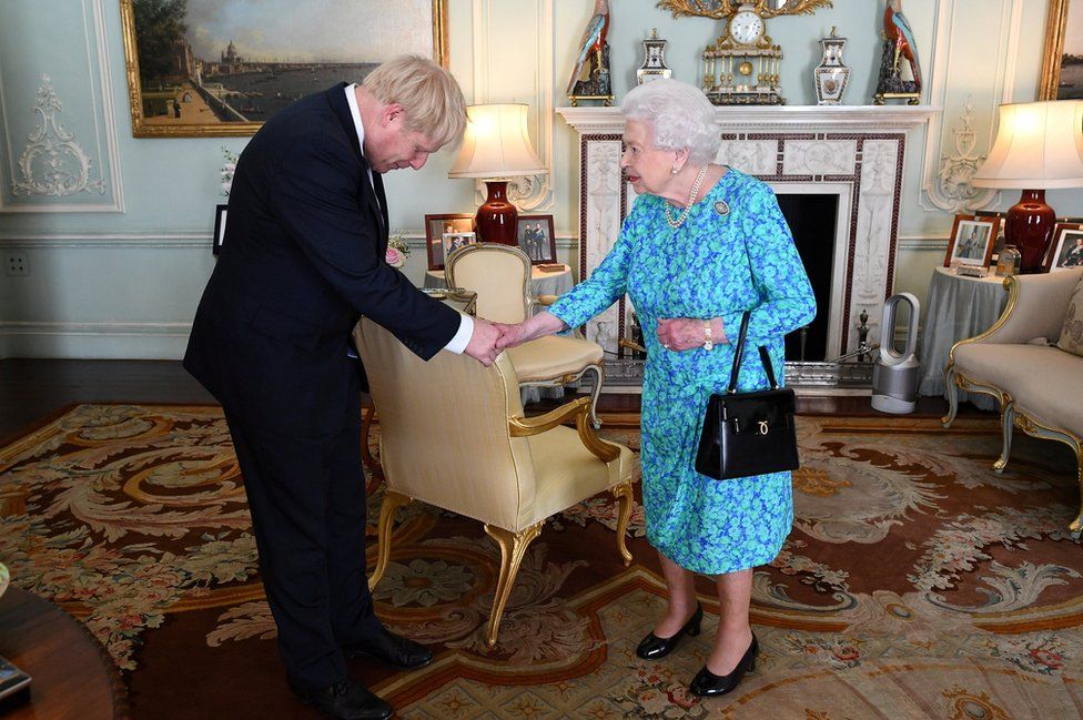 Queen Elizabeth II welcomes Boris Johnson during an audience in Buckingham Palace