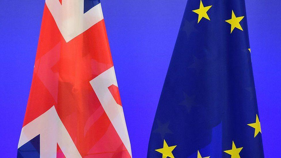 A British Union Jack flag and a European Union flag
