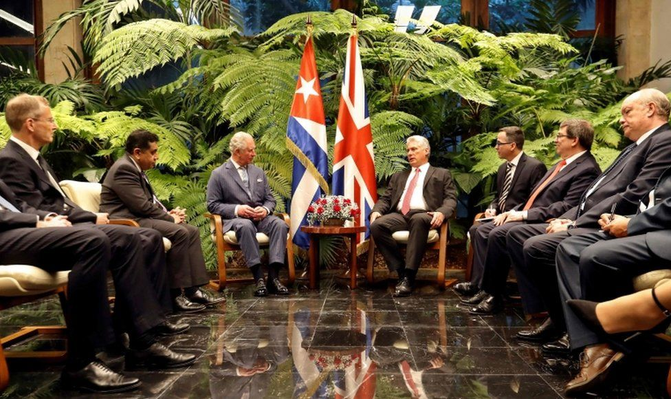 President Miguel Diaz-Canel and others sit with Prince Charles