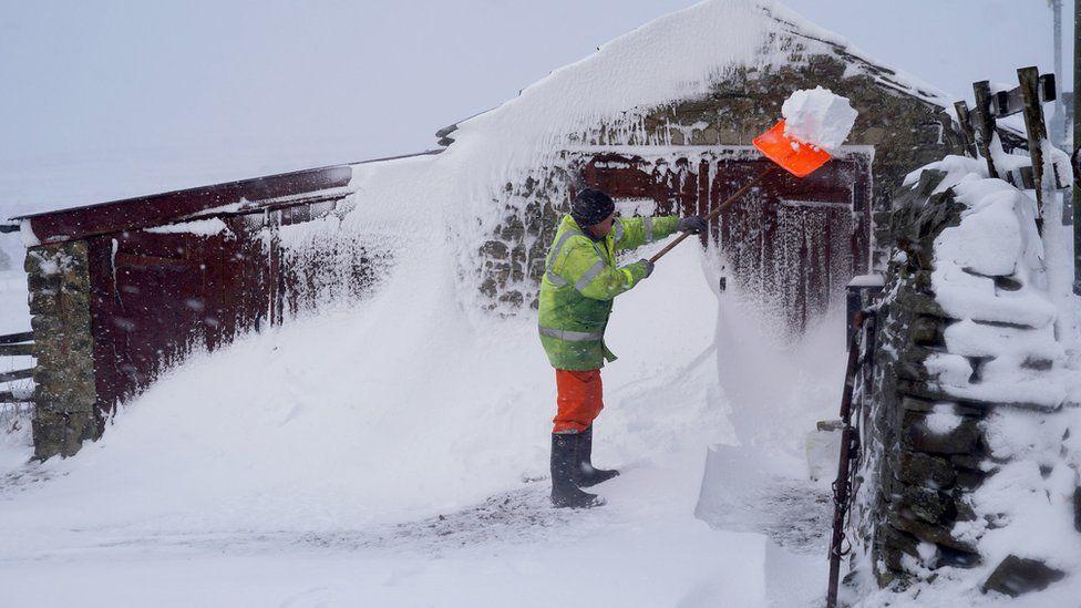 Ken Emerson clearing a snow drift in Lanehead, County Durham.