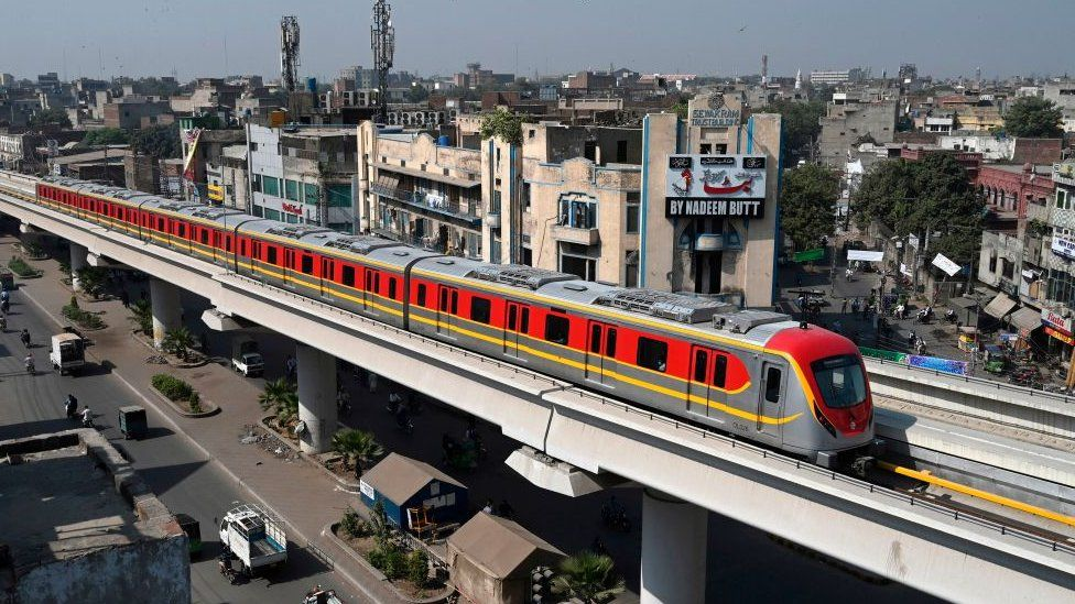 A train runs along the newly built Orange Line Metro in Lahore