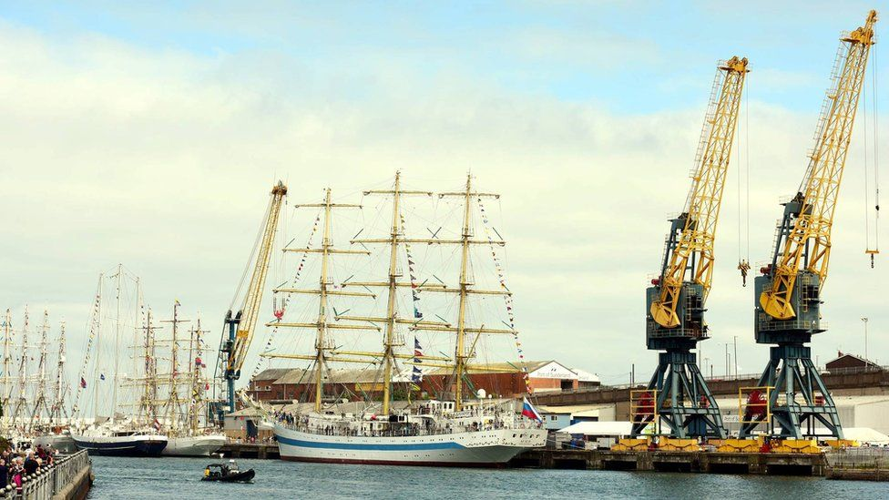 Tall ships next to cranes in Sunderland