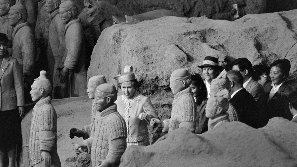 Britain's Queen Elizabeth II takes a close look at the terra-cotta warriors at the Museum of the Qin Dynasty during her visit to Xi'an, on October 16, 1986.