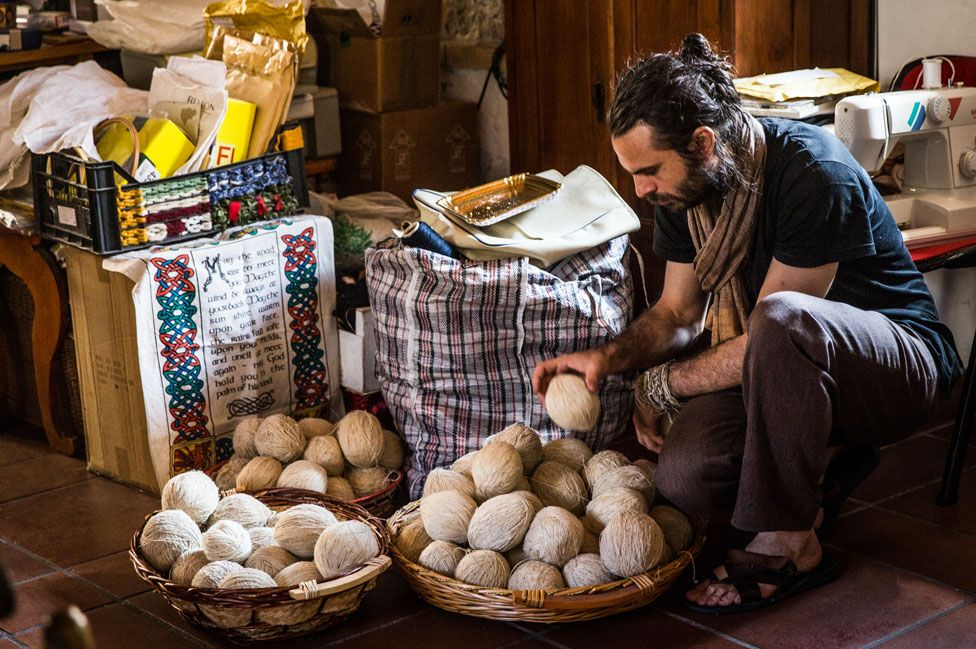 Man studying byssus weaving
