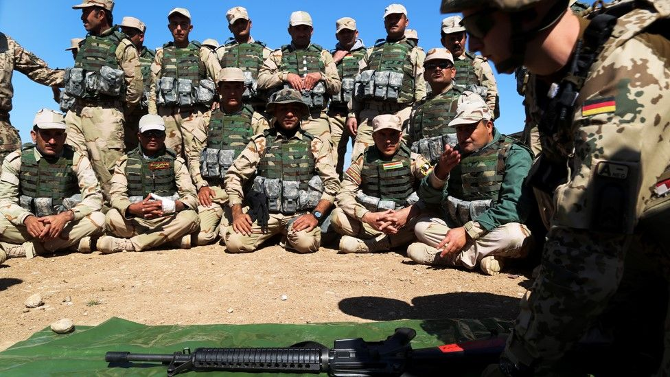 File photo showing Iraqi Kurdish Peshmerga fighters listening to a German military trainer at a camp in Irbil, Iraq (9 March 2016)