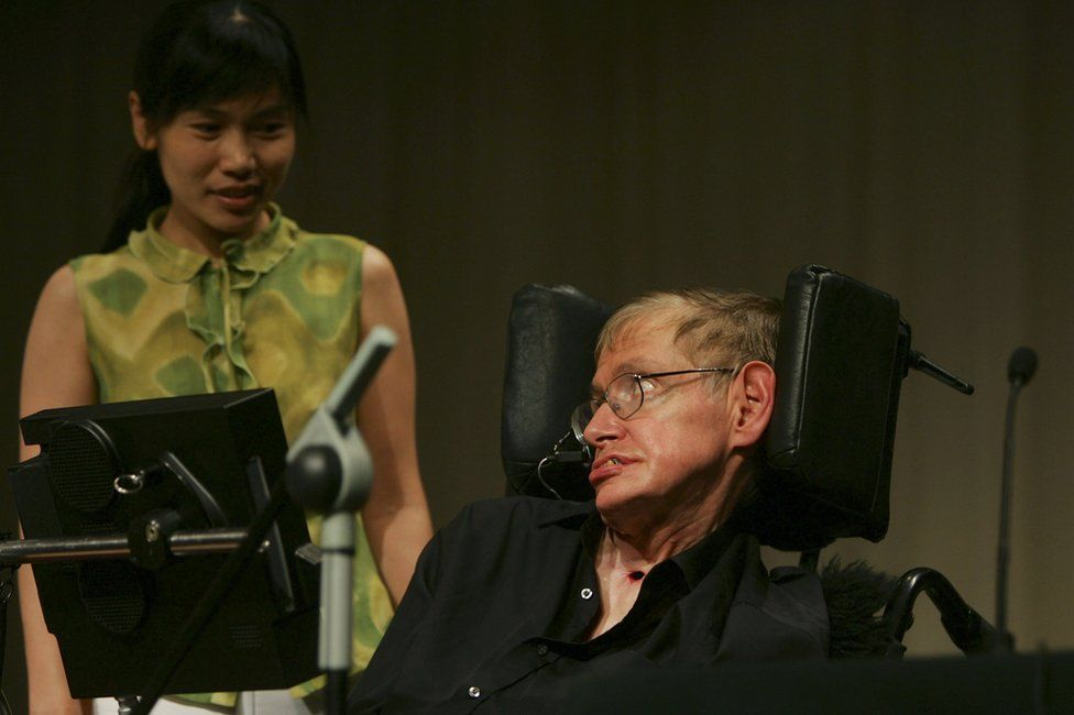British scientist Stephen Hawking looks at a Chinese student at a conference during the 2006 International Conference on String Theory on 21 June 2006 in Beijing, China