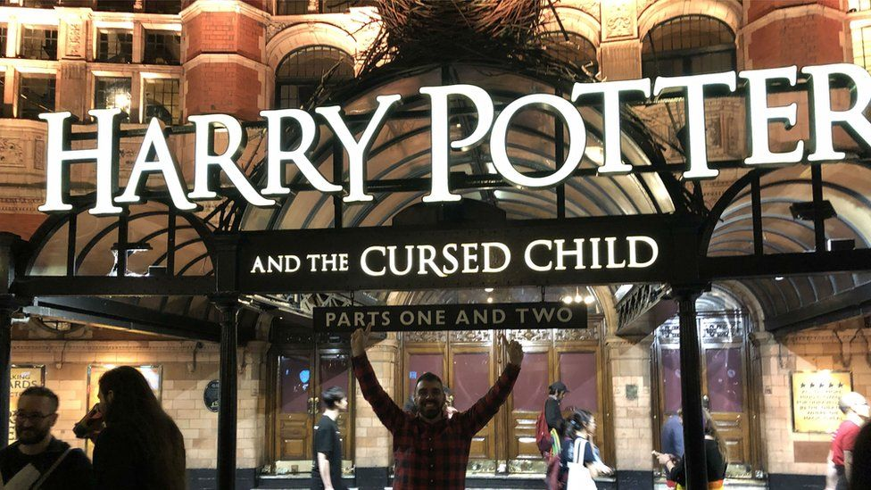 A picture of Harry Potter outside the entrance to the Harry Potter and the Cursed Child play in July.