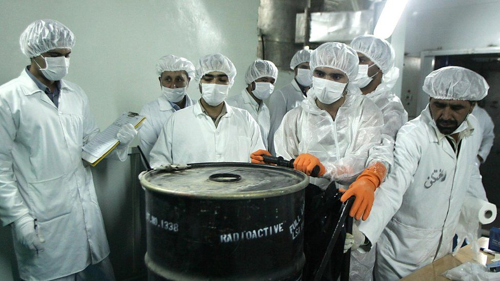 Workers at a uranium conversion facility in Iran, pictured in 2005