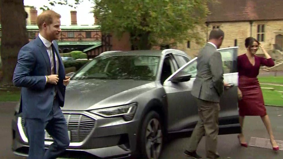 The Duke and Duchess of Sussex get out of their car as they arrive at the roundtable