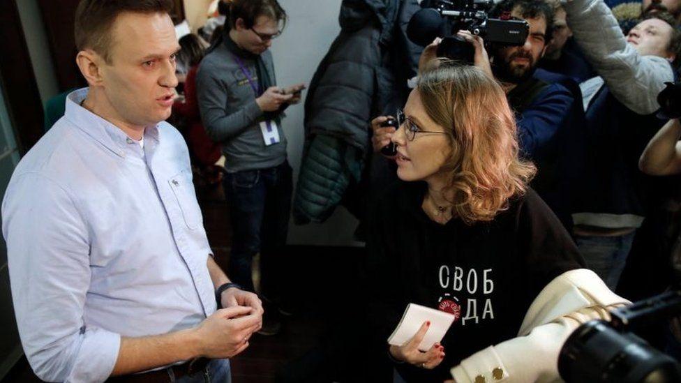 Navalny and TV journalist Ksenia Sobchak speak at event on polling day