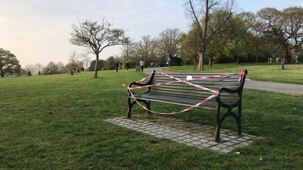 Public benches are taped off in Brockwell Park as the spread of the coronavirus disease (COVID-19) continues, London