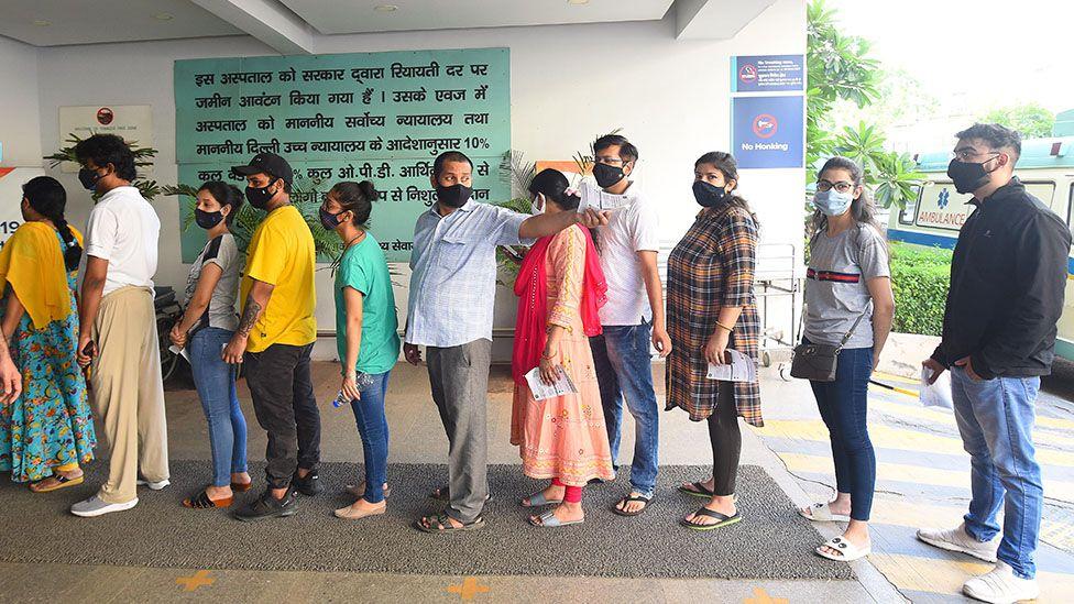 People queue to receive vaccines in Delhi, India on 6 June