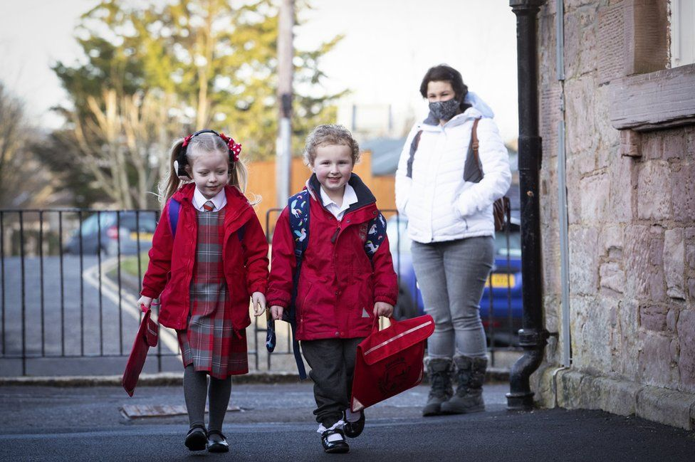 P1 pupils Grace Lee (left) and classmate Grace McKeeman, both aged 5, arrive for their first day back at Inverkip Primary School