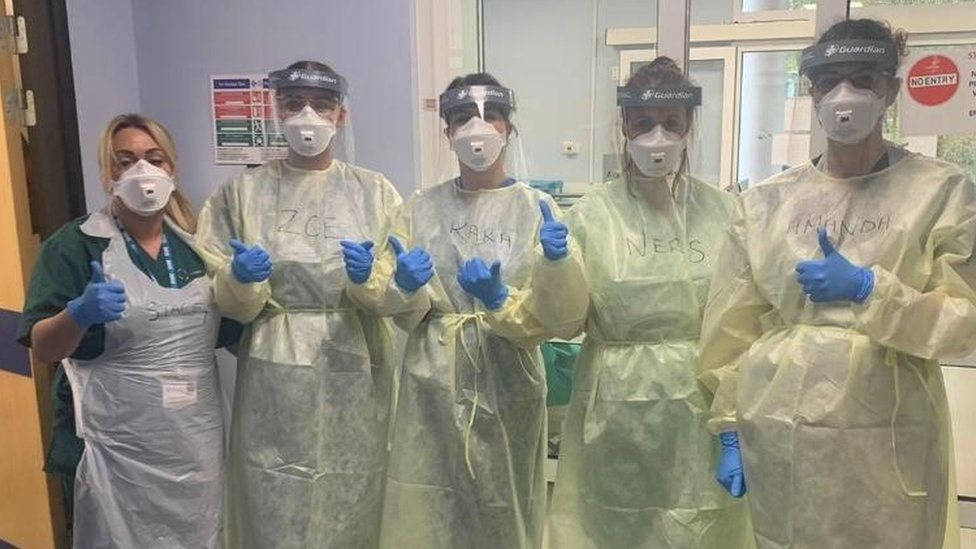 Nerys Conway and colleagues in full PPE gear
