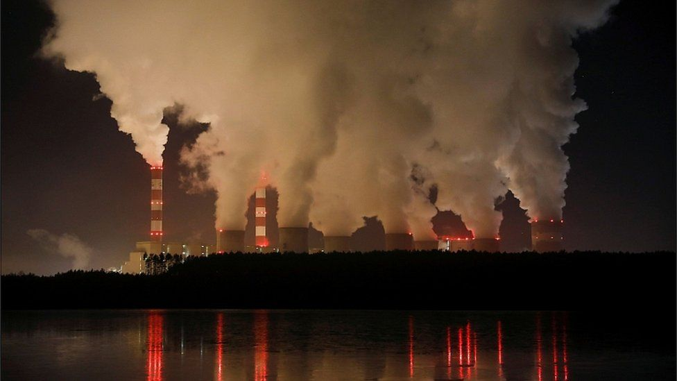 Smoke and steam billows from Belchatow Power Station, Europe's largest coal-fired power plant operated by PGE Group, at night near Belchatow, Poland December 5, 2018