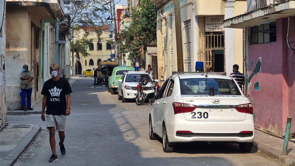 Two police cars are seen near the house of Luis Manuel Otero Alcantara, in the San Isidro neighbourhood of Havana, Cuba on 30 April