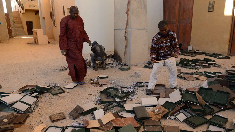 File photos from 2013 show damaged manuscripts in the Ahmed Baba Centre for Documentation and Research in Timbuktu