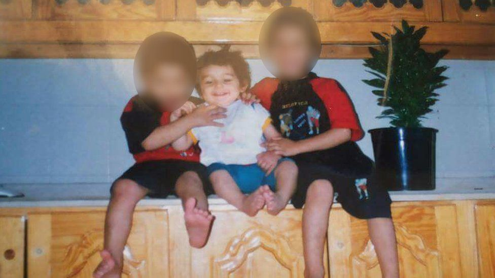 Samar aged one, with his two brothers