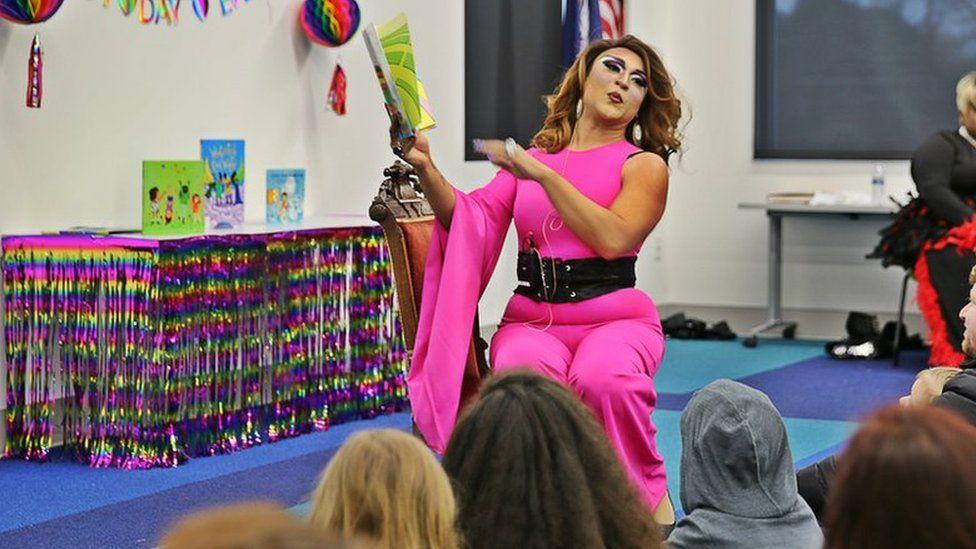 Drag Queen Princess Mocha reading to children