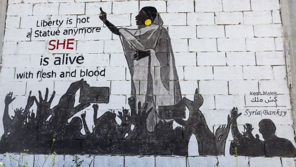 "A mural painting of Alaa Salah painted by a Syrian artists collective called ""Kesh Malek"" (Checkmate) on the wall of a farmhouse building in the rebel-held Syrian town of Kafranbel in the north-western Idlib province - 12 April 2019"