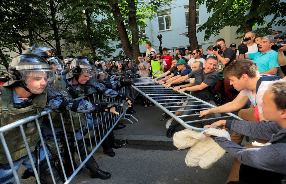Police and protesters in Moscow, 27 July