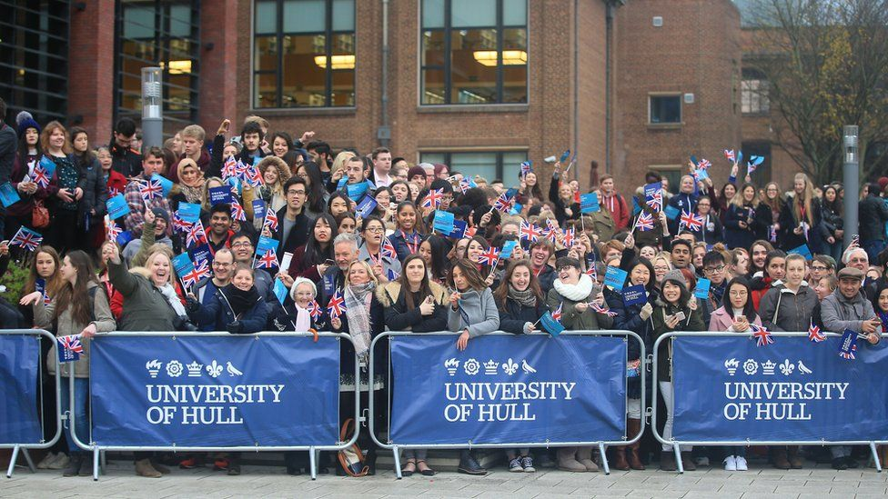 University of Hull staff and students cheering with union jack flags