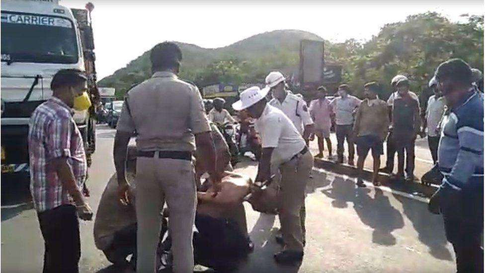 Police tie Dr Rao's hands