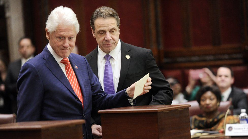 Former President Bill Clinton, left, votes for president at the state capitol in Albany, New York
