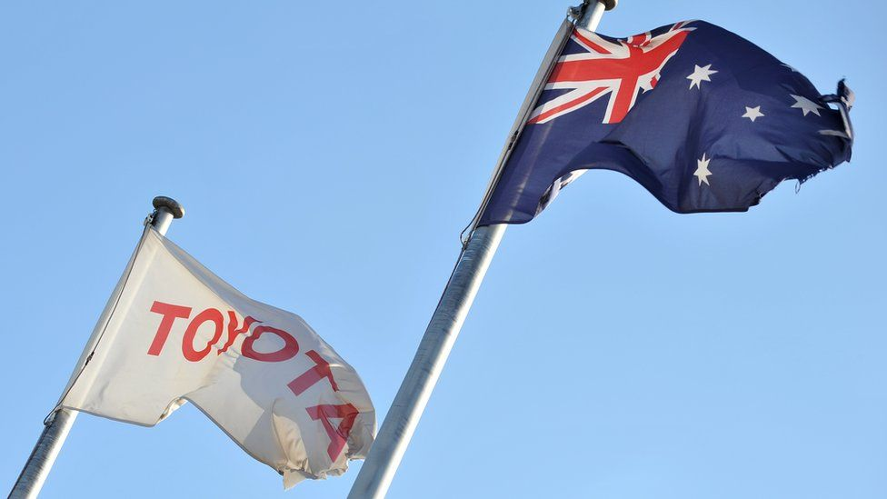 Toyota flag flies next to the Australian flag