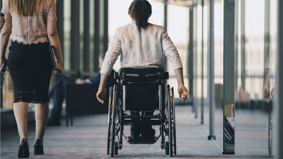 A wheelchair user seen from behind