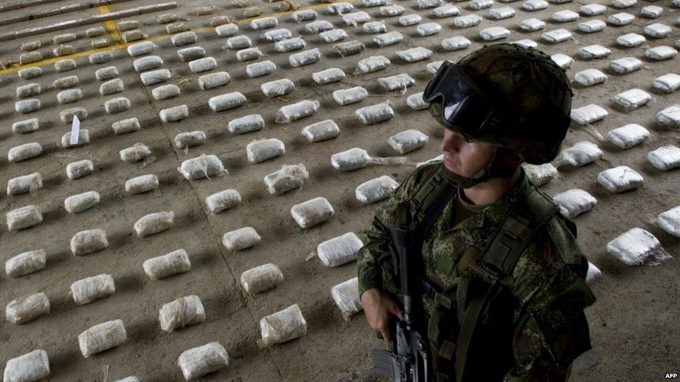 A Colombian soldier with bags of seized cocaine in Choco
