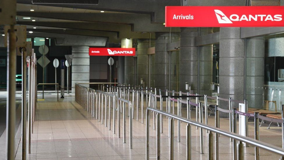 A deserted Qantas domestic arrivals terminal in Sydney, Australia.