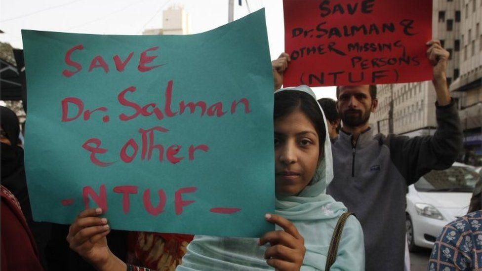 Activists of Pakistan civil society rally to condemn the missing human rights activist Salman Haider, in Karachi, Pakistan, Monday, January 9, 2017