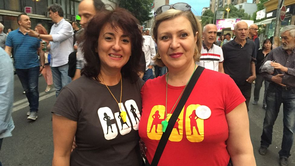 """Opposition protesters models the """"Charlie's Angels"""" t-shirt"""