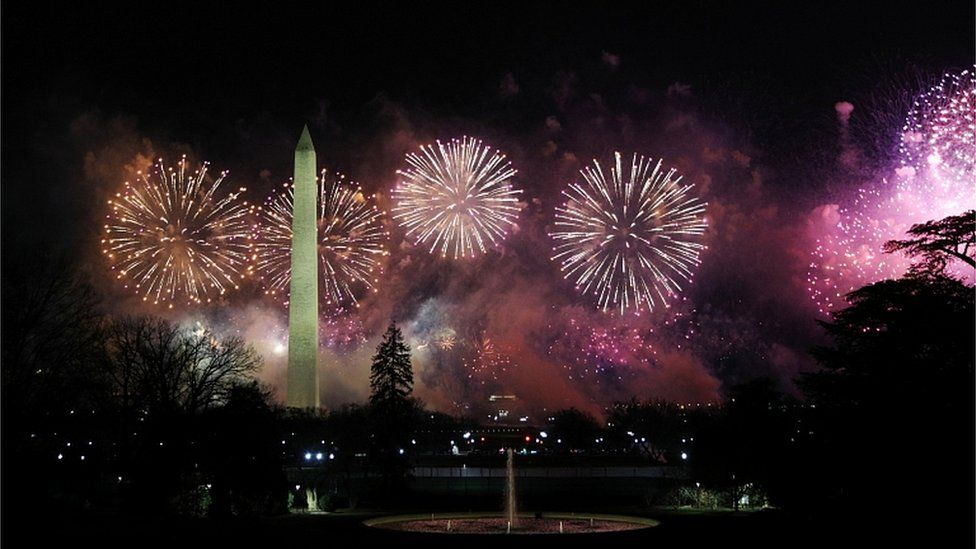 "Fireworks burst over the Washington Monument during the ""Celebrating America"" event in Washington, DC., January 20, 2021"