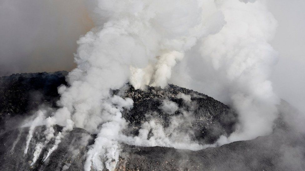 Aerial view of Colima volcano spewing smoke and ash on September 30, 2016