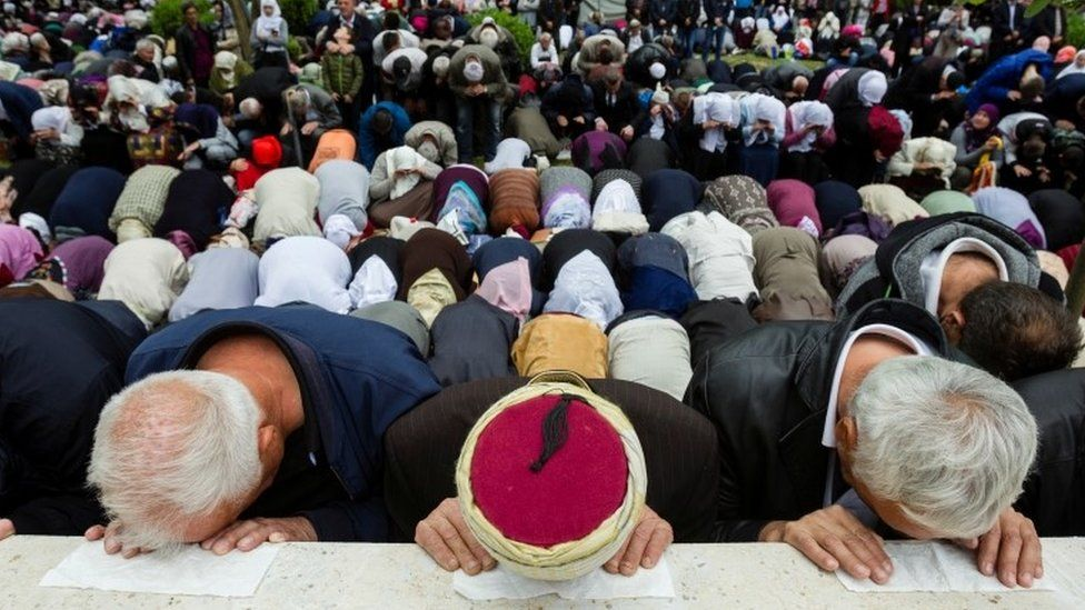 Muslims pray at the mosque, which was notorious for killings during the war