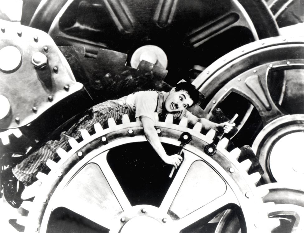 Charlie Chaplin getting trapped in a machine