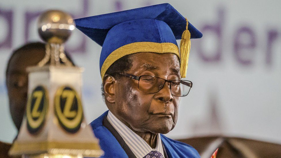 Mr Mugabe, 93, in cap and gown, as he presides over a graduation ceremony this week