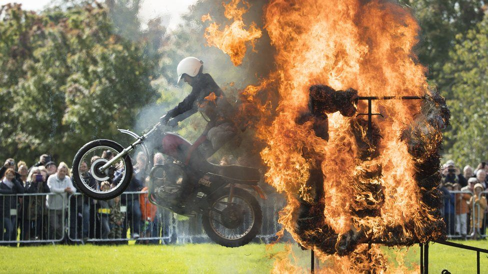 rider leaps through ring of fire