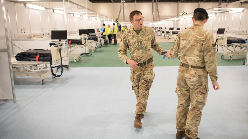 Military personnel is seen at ExCel London, during its conversion into the temporary NHS Nightingale Hospital, comprising of two wards, each of 2,000 people, to help tackle the coronavirus disease (COVID-19) outbreak, in London