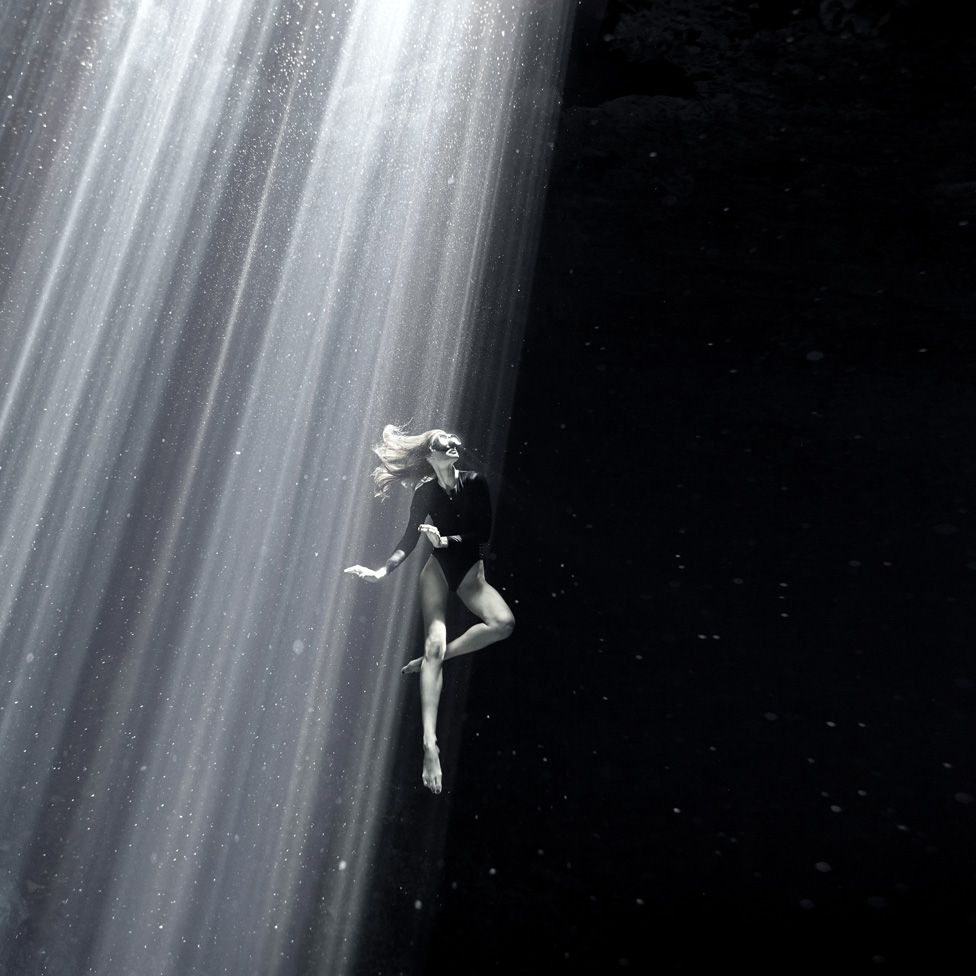 Flavia Eberhard diving in the Yucatan Peninsula, Mexico.