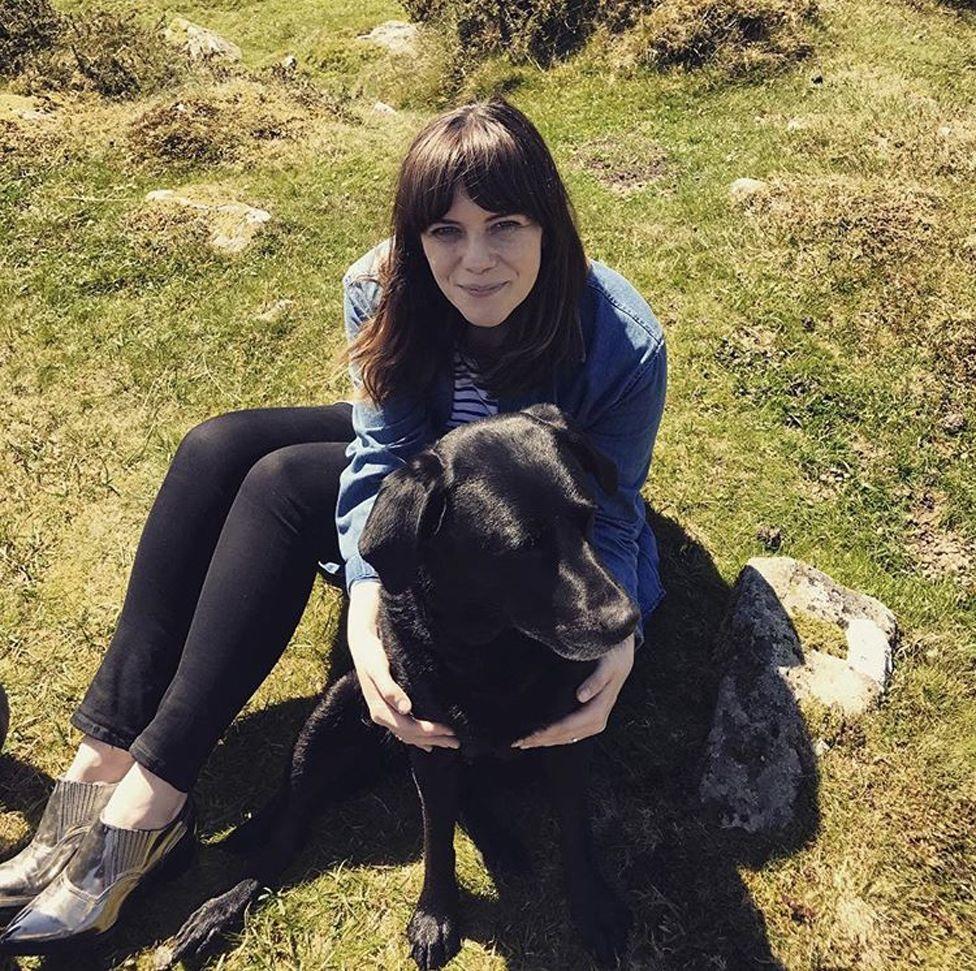 Michelle hugging a dog